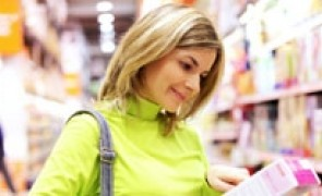 Consumer selecting a product in a supermarket.